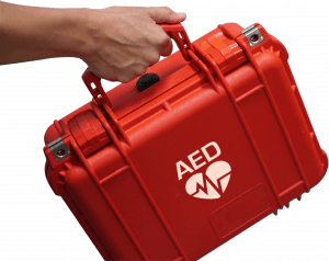 Hand holding AED