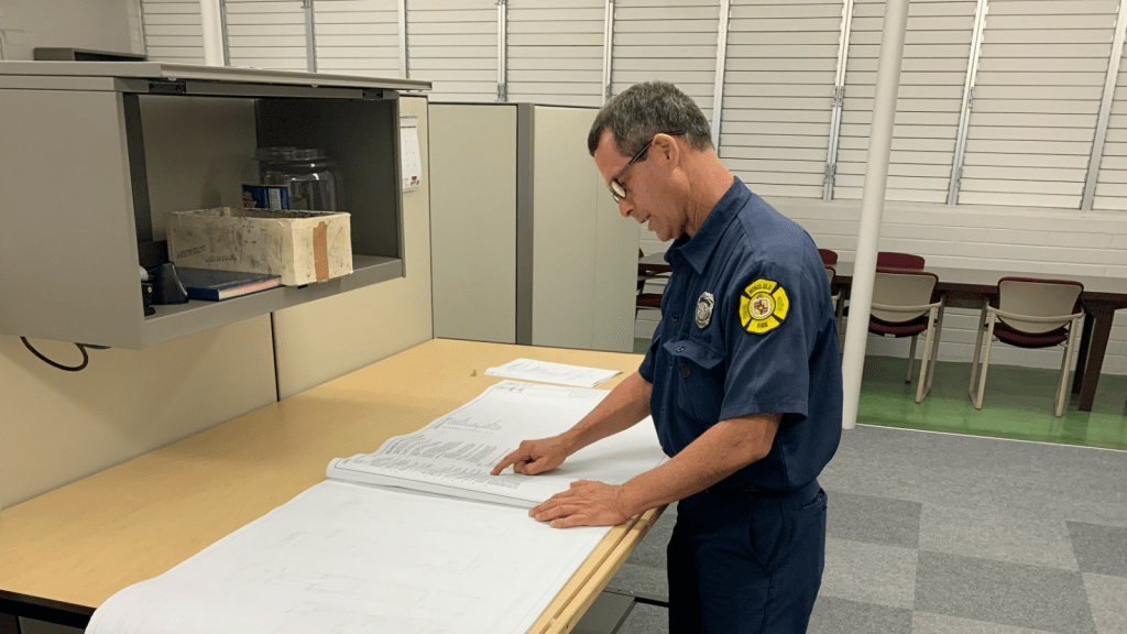 Fire inspector checking a document