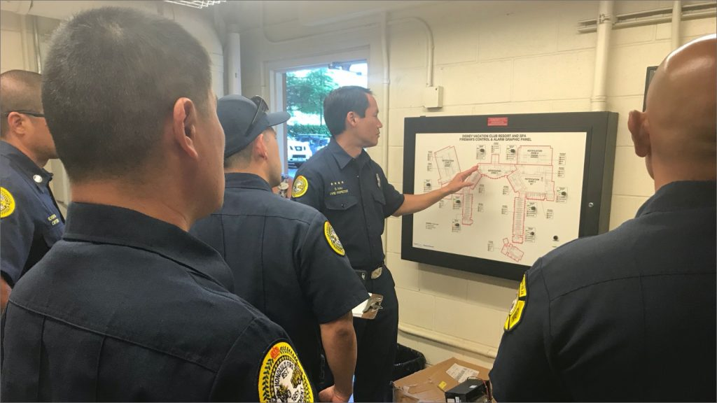 Fire inspectors reviewing a wall map
